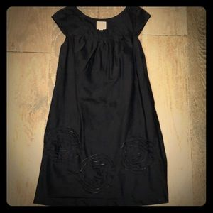Suci chin Black dress with laser cut rosettes